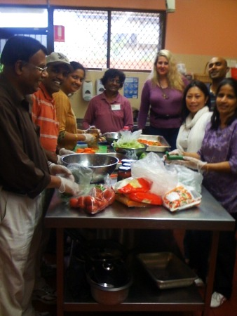 Devotees from Toongabbie, Hoxton Park and Cabramatta preparing service at the St Vincent De Paul Homeless Men's Hostel, Granville, NSW