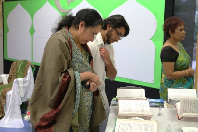 Participants examine the sacred texts of Islam