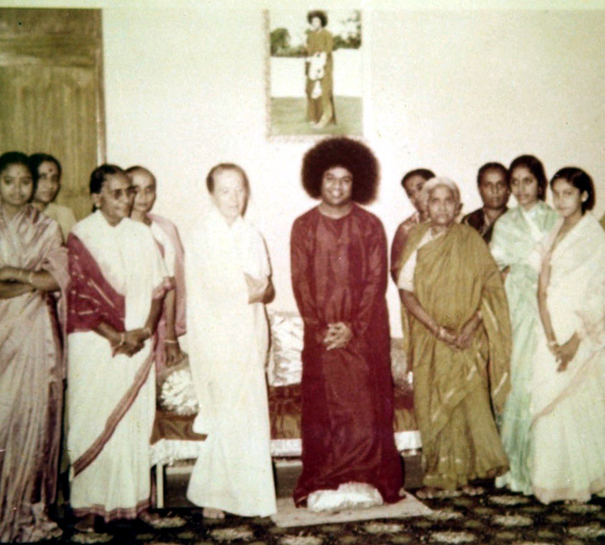 Sathya Sai with lady devotees. His mother Easwaramma is on the right in green.